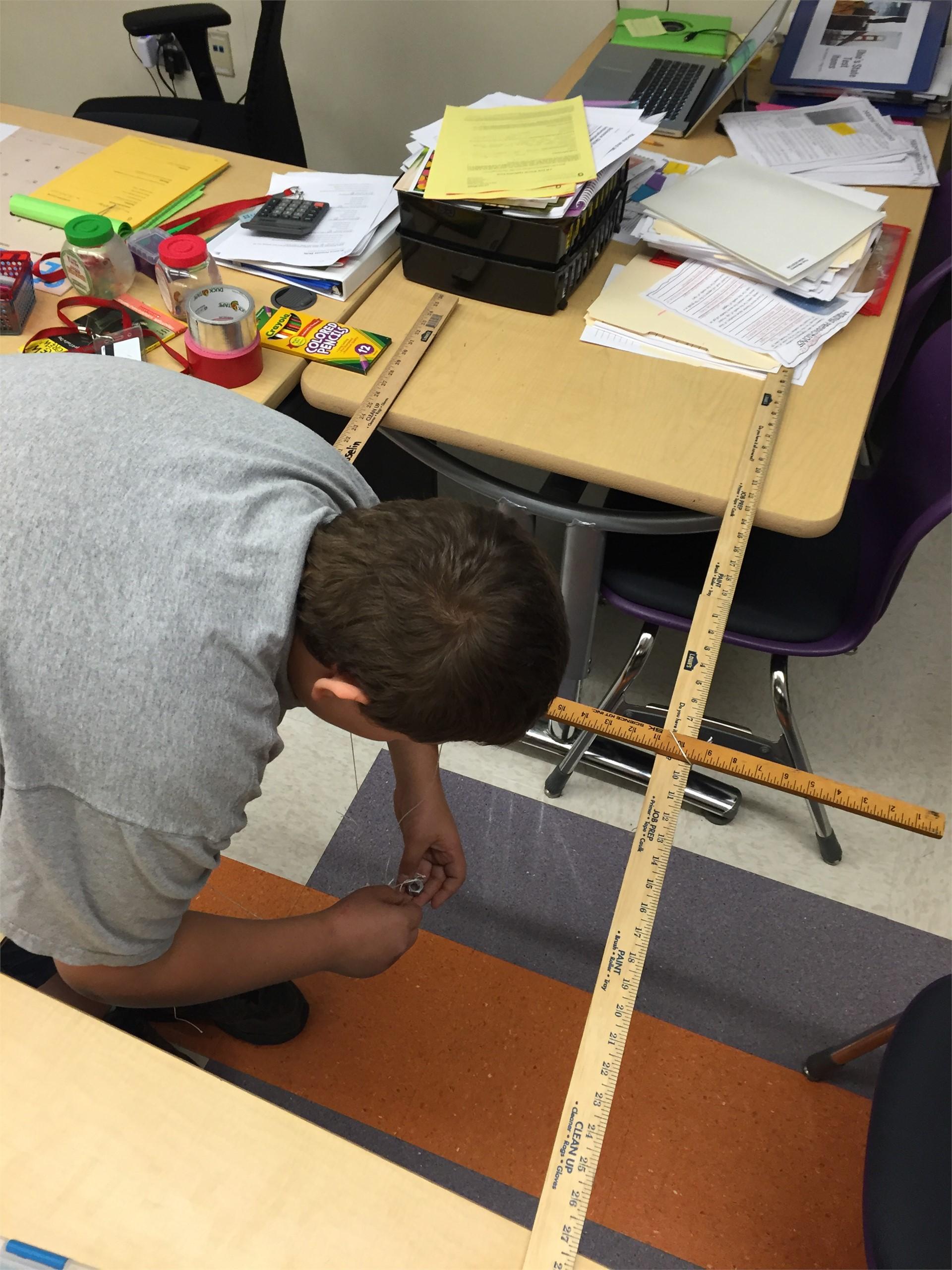 Michael creating his own pendulum!
